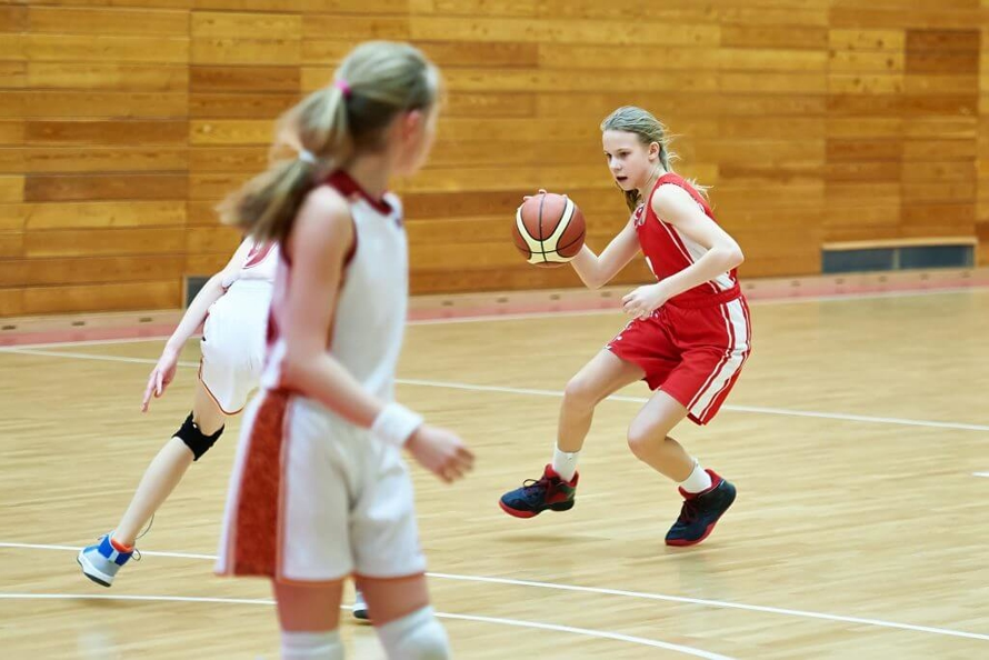 Little Girl in a Red Jersey Playing Basketball