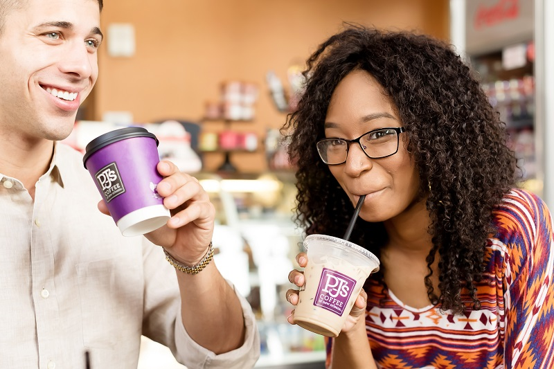 young couple drinking PJ's Coffee beverages